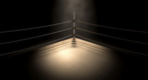 Classic Vintage Boxing Ring Corner. A closeup of the corner of an old vintage boxing ring surrounded by ropes spotlit by a spotlight on an isolated dark Stock Image