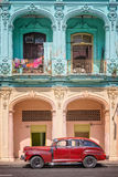Classic Vintage Car And Coloful Colonial Buildings In Old Havana