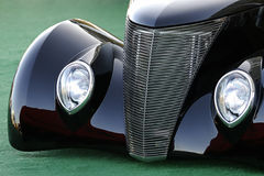 Classic Vintage Car in Black. Classic old Ford car; shot shows only the front grill and headlights Stock Images