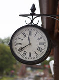 Classic vintage clock at old railway station Stock Photos