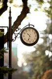 Classic vintage clock, railway station. In summer time Stock Photo