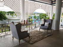Classic vintage gray sofa set on a terrace. Stock Images