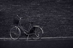 Classic vintage hipster retro bicycle leaning against the street Stock Photos