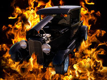 Classic Vintage Hot Rod Car Automobile Flames. Cool black hot rod automobile in flames Royalty Free Stock Image