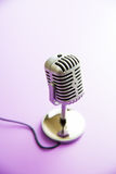 Classic vintage microphone. Classic vintage microphone on colorful background Stock Image