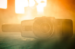 Classic vintage old 8mm movie camera on table with fog close up. Selective focus. Old Soviet Camera Royalty Free Stock Photos