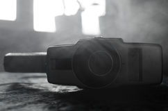 Classic vintage old 8mm movie camera on table with fog close up. Selective focus. Old Soviet Camera Stock Photos