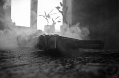 Classic vintage old 8mm movie camera on table with fog close up. Selective focus. Old Soviet Camera Stock Photo