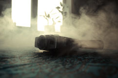 Classic vintage old 8mm movie camera on table with fog close up. Selective focus. Old Soviet Camera Stock Image