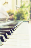 Classic vintage old piano keyboard shallow depth Stock Photos