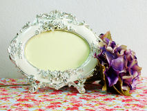 Classic vintage picture frame with beautiful hydrangea of artificial flowers Royalty Free Stock Photo