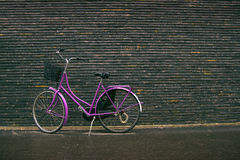 Classic Vintage Purple Hipster Bicycle on the Street Stock Images