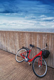 Classic Vintage Red Bicycle Leaning Against Wall Stock Photo
