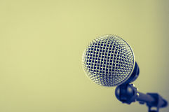 The classic vintage silver microphone on green background.  Royalty Free Stock Image