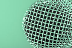 The classic vintage silver microphone on green background.  Stock Images