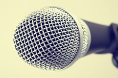 The classic vintage silver microphone on green background.  Royalty Free Stock Images