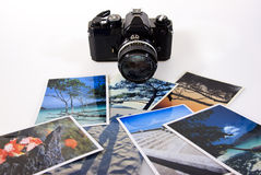 Classic vintage slr film camera with photographs Royalty Free Stock Photography