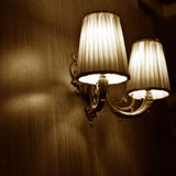 Classic vintage wall lamps. In sepia tone royalty free stock photos