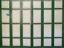 Classic vintage wood folding doors with light, home wall Stock Photography