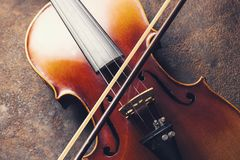 Old Violin with bow. Classic Violin with bow on a rusty background. ideal for websites and magazines layouts Stock Image