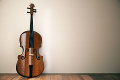 Classic violin in room. Classic wooden violin leaning on wall in simple interior with wooden floor. Music concept. 3D Rendering Stock Photography