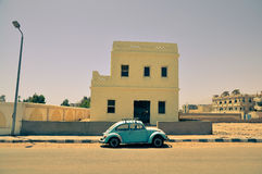 Classic Volkswagen Beetle car. In the street of Egyptian town Stock Images