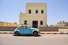 Classic Volkswagen Beetle car. In the street of Egyptian town Royalty Free Stock Photos