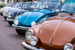 Classic volkswagen beetle in a row royalty free stock photos