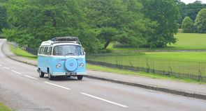 Classic VW Camper Van on country road. royalty free stock images