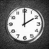 Classic wall clock on black grunge wall Royalty Free Stock Photo