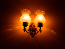 Classic wall lamp. In dark room Royalty Free Stock Photo