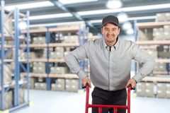 Delivery man in warehouse Royalty Free Stock Photography