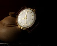 Classic watch. Classic golden watch over black background stock photos