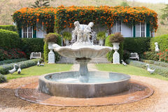 Classic water fountain in the garden. Back house royalty free stock images
