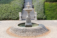 Classic water fountain in the garden. Royalty Free Stock Image