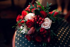 Classic wedding bouquet with red flowers and decoration Royalty Free Stock Photo