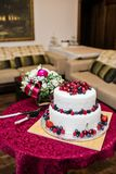 Classic wedding cake with raspberries, strawberries, blackberries and blueberries royalty free stock image