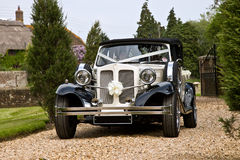 Classic Wedding Car. Vintage wedding car in white Stock Photos