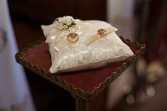 Classic wedding ceremony golden rings on a pillow in the old chu Royalty Free Stock Photos