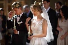 Classic wedding ceremony of stylish young luxury bride and groom Stock Image