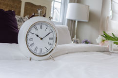 Classic white alarm clock style in classic bedroom Royalty Free Stock Photos