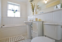 Classic white bathroom. Lovely decorated classic white bathroom Royalty Free Stock Photo