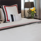 Classic white bed with pillows and classic lamp style on table s. Ide at home stock photography