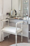 Classic white chair with dressing table. At home stock photos
