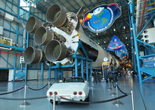 Classic White Corvette and Saturn V Rocket Royalty Free Stock Photography