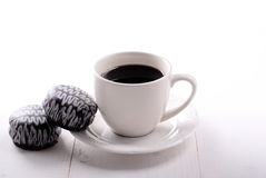 Classic white cup of coffee with chocolate cookies Stock Photography