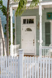 Classic White Door Behind Picket Fence Royalty Free Stock Image