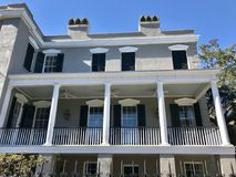A classic white house in the center of Savannah, Georgia. Savannah, a coastal Georgia city, is separated from South Carolina by the Savannah River. It's royalty free stock photos