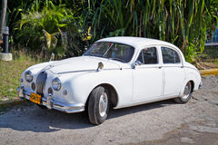 Classic white Jaguar in Havana. Cuba Royalty Free Stock Images