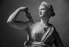 Classic white marble statuette Diana of Versailles Stock Photos